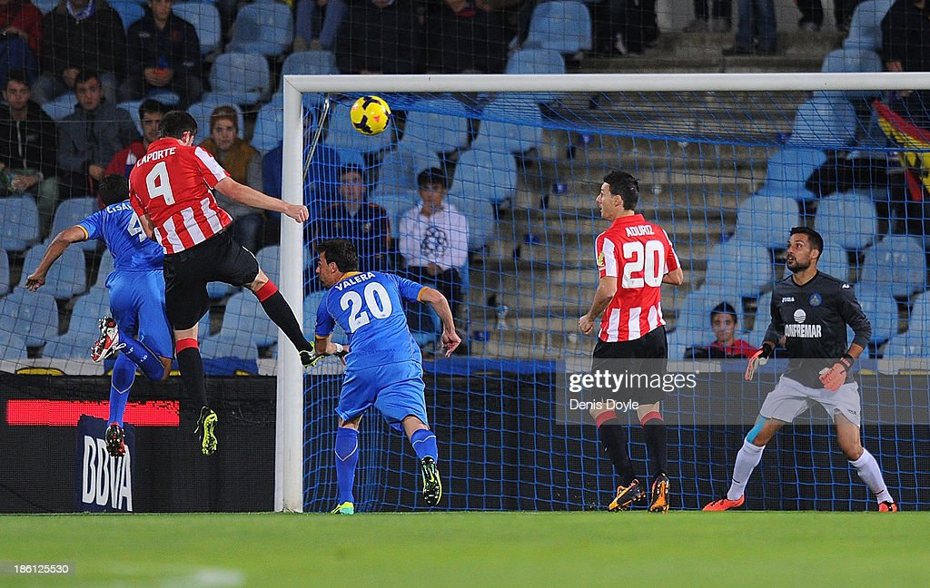 Aymeric Laporte (#4) of Athletic Club scores his team's opening goal during the La Liga match between Getafe CF and Athletic Club at Coliseum Alfonso Perez stadium on October 28, 2013 in Getafe, Spain.