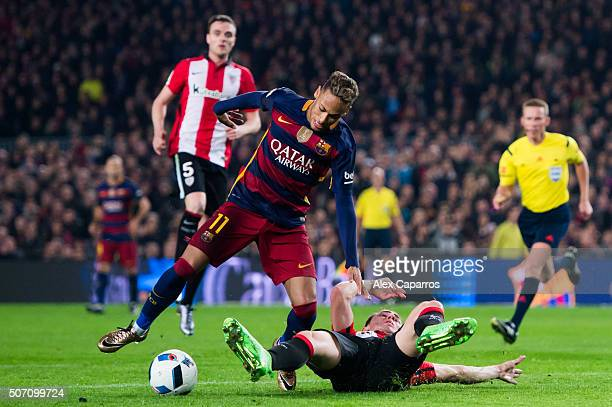 Aymeric Laporte of Athletic Club tackles Neymar Santos Jr of FC Barcelona during the Copa del Rey Quarter Final Second Leg between FC Barcelona and...