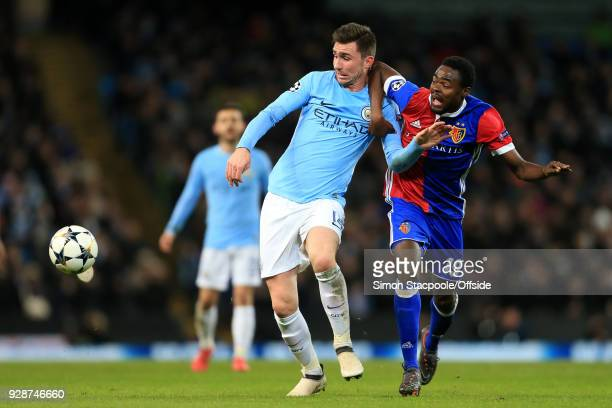 Aymeric Laporte of Man City battles with Dimitri Oberlin of Basel during the UEFA Champions League Round of 16 Second Leg match between Manchester...