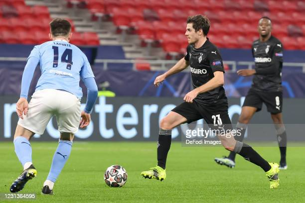 Aymeric Laporte of Manchester City and Jonas Hofmann of Borussia Moenchengladbach battle for the ball during the UEFA Champions League Round of 16...