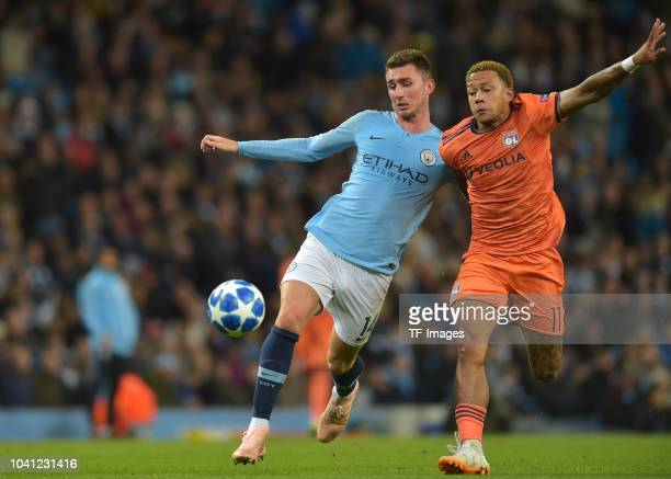 Aymeric Laporte of Manchester City and Memphis Depay of Lyon battle for the ball during the UEFA Champions League Group F match between Manchester...