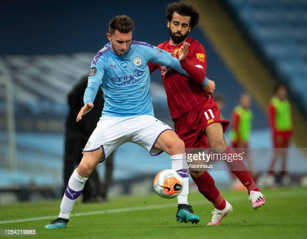 Aymeric Laporte of Manchester City and Mohamed Salah of Liverpool in action during the Premier League match between Manchester City and Liverpool FC...