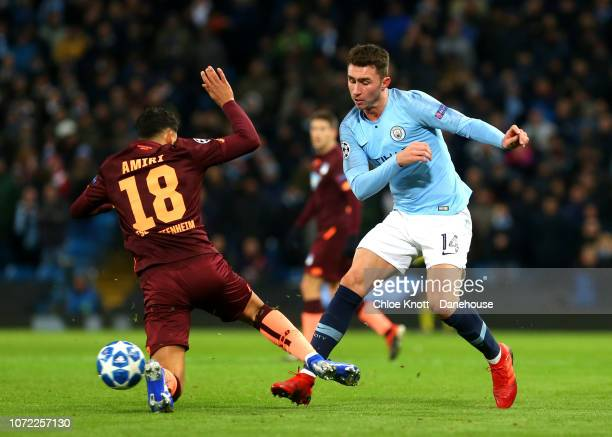 Aymeric Laporte of Manchester City and Nadiem Amiri of TSG Hoffenheim compete for the ball during the UEFA Champions League Group F match between...