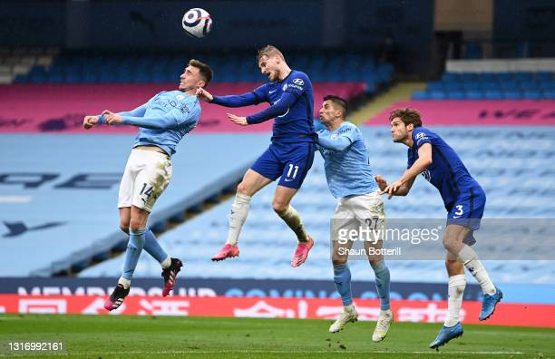 Aymeric Laporte of Manchester City battles for a header with Timo Werner of Chelsea as Joao Cancelo of Manchester City and Marcos Alonso of Chelsea...