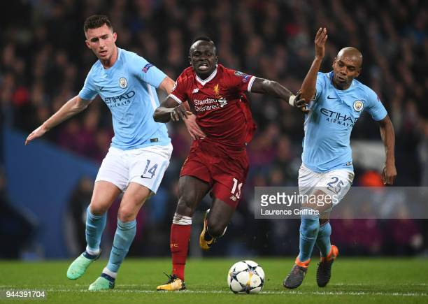 Aymeric Laporte of Manchester City battles for posession with Sadio Mane of Liverpool and Fernandinho of Manchester City during the UEFA Champions...