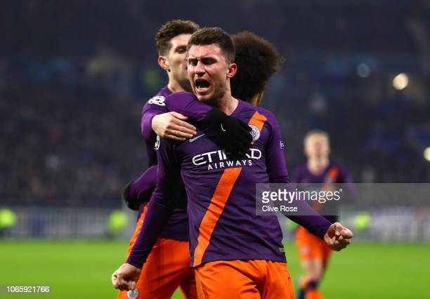 Aymeric Laporte of Manchester City celebrates after scoring his team's first goal with team mates during the Group F match of the UEFA Champions...