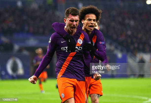 Aymeric Laporte of Manchester City celebrates after scoring his team's first goal with team mate Leroy Sane during the Group F match of the UEFA...