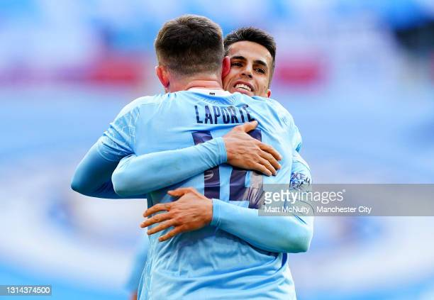 Aymeric Laporte of Manchester City celebrates Joao Cancelo after scoring their side's first goal during the Carabao Cup Final between Manchester City...