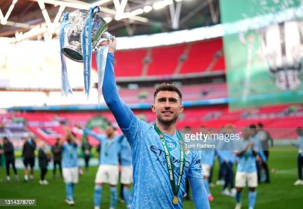 Aymeric Laporte of Manchester City Celebrates with Carabao Cup Trophy following their side's victory in the Carabao Cup Final between Manchester City...
