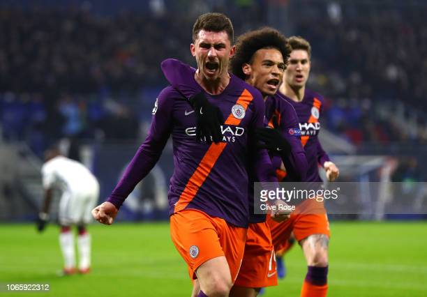 Aymeric Laporte of Manchester City celebrates with his team mate Leroy Sane after scoring his team's first goal during the Group F match of the UEFA...