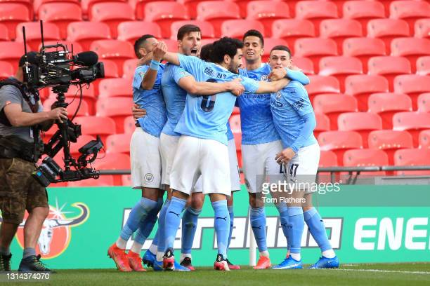 Aymeric Laporte of Manchester City celebrates with Ilkay Gundogan, Ferran Torres and Phil Foden after scoring their side's first goal during the...