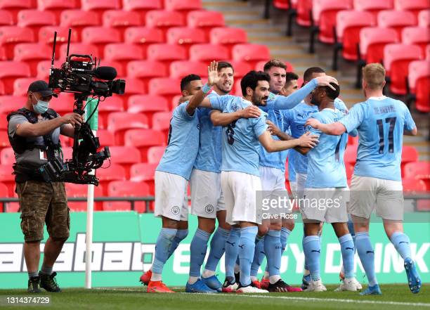 Aymeric Laporte of Manchester City celebrates with Ilkay Gundogan, Raheem Sterling and Kevin De Bruyne after scoring their side's first goal during...