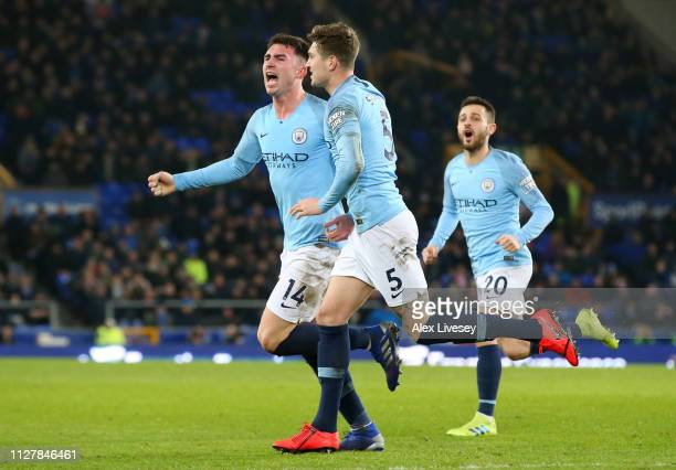 Aymeric Laporte of Manchester City celebrates with John Stones of Manchester City after he scores his sides first goal during the Premier League...