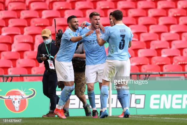 Aymeric Laporte of Manchester City celebrates with Riyad Mahrez and Ruben Dias after scoring their side's first goal during the Carabao Cup Final...