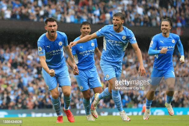Aymeric Laporte of Manchester City celebrates with Ruben Dias after scoring their side's third goal during the Premier League match between...