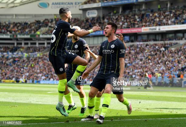 Aymeric Laporte of Manchester City celebrates with teammate Riyad Mahrez after scoring his team's second goal during the Premier League match between...