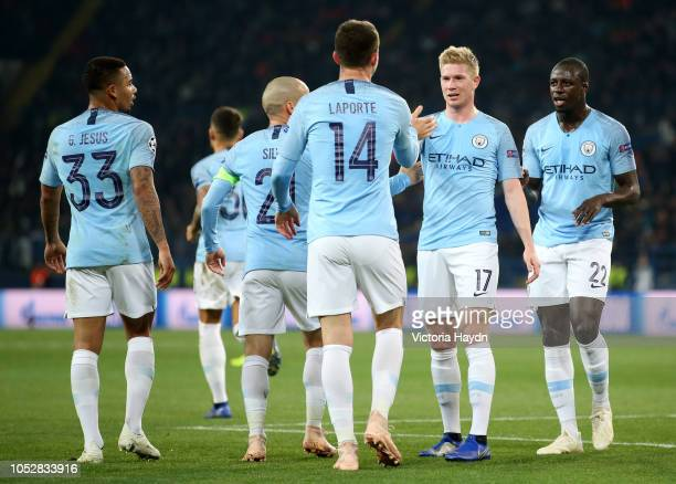 Aymeric Laporte of Manchester City celebrates with teammates after scoring his team's second goal during the Group F match of the UEFA Champions...