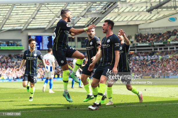 Aymeric Laporte of Manchester City celebrates with teammates after scoring his team's second goal during the Premier League match between Brighton...