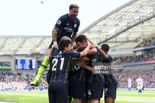Aymeric Laporte of Manchester City celebrates with teammates after scoring his team's second goal as Kyle Walker of Manchester City jumps on top...