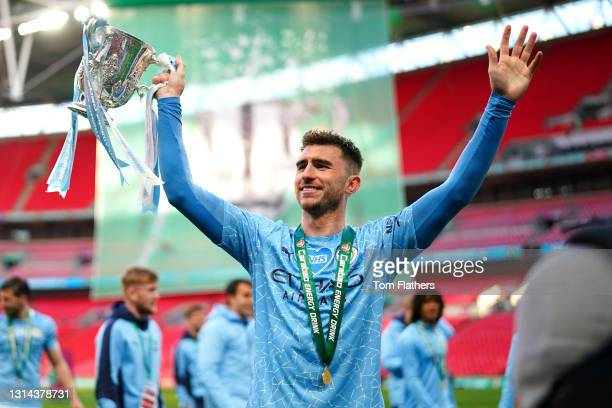 Aymeric Laporte of Manchester City Celebrates with the Carabao Cup Trophy following their side's victory in the Carabao Cup Final between Manchester...
