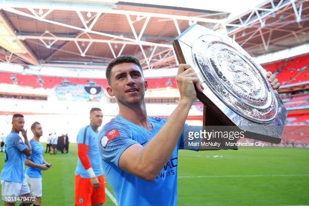 Aymeric Laporte of Manchester City celebrates with the FA Community Shield Trophy following his sides victory in the FA Community Shield between...