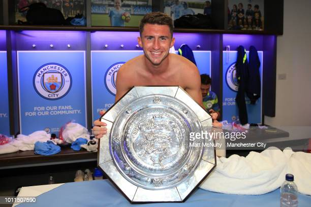 Aymeric Laporte of Manchester City celebrates with the FA Community Shield Trophy in the dressing room following his sides victory in the FA...