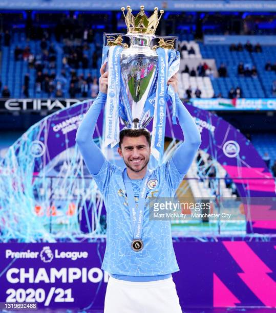 Aymeric Laporte of Manchester City celebrates with the trophy during the Premier League match between Manchester City and Everton at Etihad Stadium...