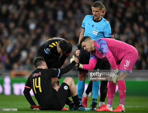Aymeric Laporte of Manchester City goes down injured during the UEFA Champions League round of 16 first leg match between Real Madrid and Manchester...