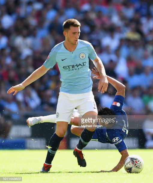 Aymeric Laporte of Manchester City holds off Pedro of Chelsea during the FA Community Shield between Manchester City and Chelsea at Wembley Stadium...