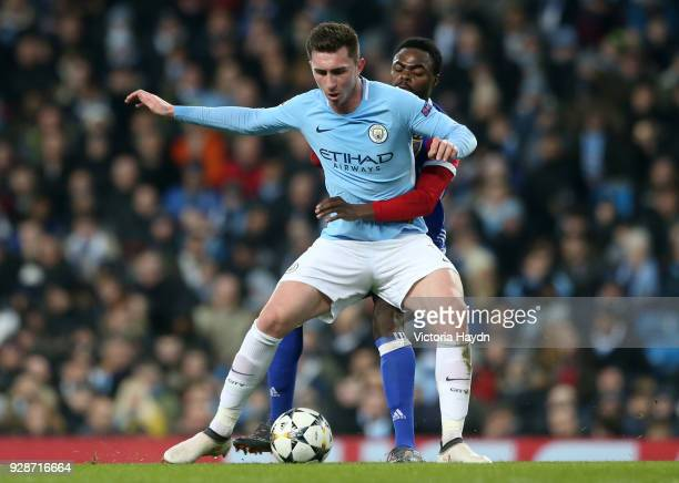 Aymeric Laporte of Manchester City holds off pressure from Dimitri Oberlin of FC Basel during the UEFA Champions League Round of 16 Second Leg match...