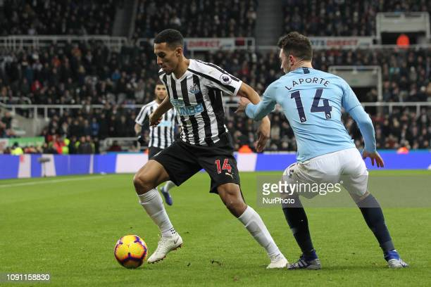Aymeric Laporte of Manchester City in action with Isaac Hayden of Newcastle United during the Premier League match between Newcastle United and...