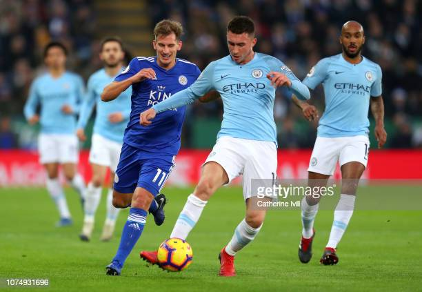 Aymeric Laporte of Manchester City is challenged by Marc Albrighton of Leicester City during the Premier League match between Leicester City and...