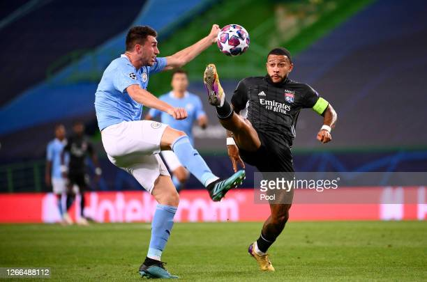 Aymeric Laporte of Manchester City is challenged by Memphis Depay of Olympique Lyon during the UEFA Champions League Quarter Final match between...