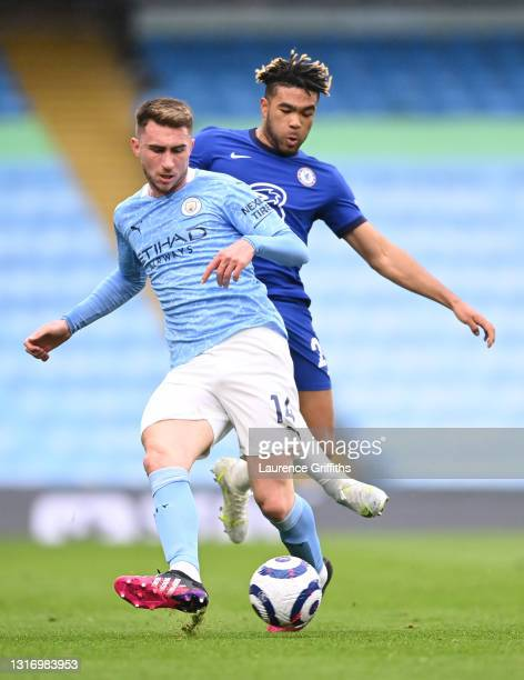 Aymeric Laporte of Manchester City is closed down by Reece James of Chelsea during the Premier League match between Manchester City and Chelsea at...