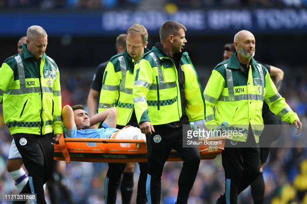 Aymeric Laporte of Manchester City is stretchered off the pitch during the Premier League match between Manchester City and Brighton Hove Albion at...