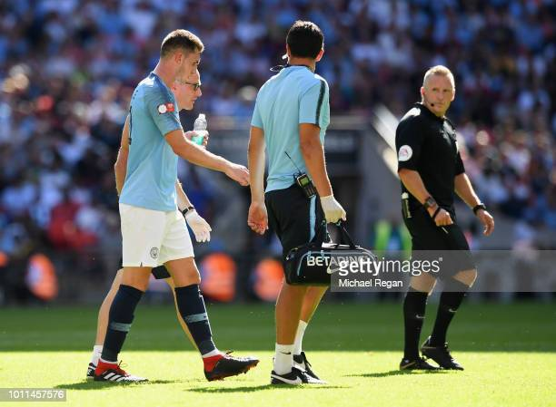 Aymeric Laporte of Manchester City leaves the field injured during the FA Community Shield between Manchester City and Chelsea at Wembley Stadium on...