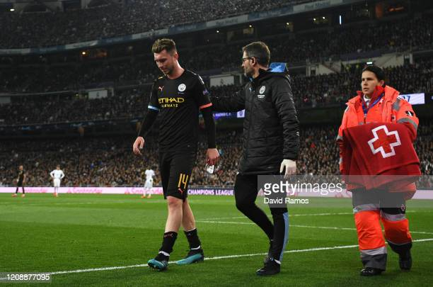 Aymeric Laporte of Manchester City leaves the pitch due to injury during the UEFA Champions League round of 16 first leg match between Real Madrid...