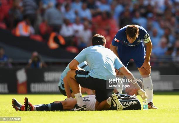 Aymeric Laporte of Manchester City lies injured during the FA Community Shield between Manchester City and Chelsea at Wembley Stadium on August 5...