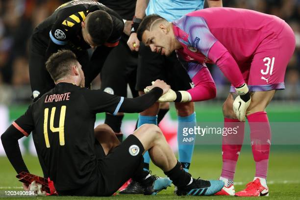 Aymeric Laporte of Manchester City Manchester City goalkeeper Ederson during the UEFA Champions League round of 16 first leg match between Real...