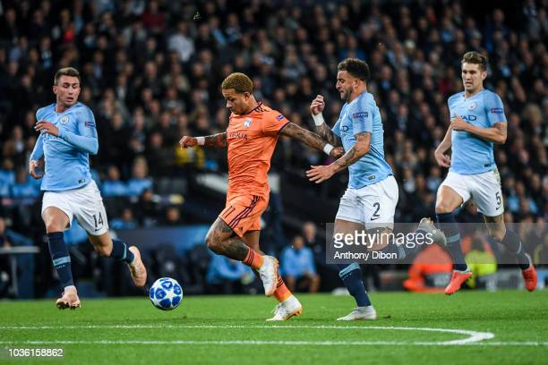 Aymeric Laporte of Manchester City Memphis Depay of Lyon Kyle Walker an john Stones of Manchester City during the Champions League match between...