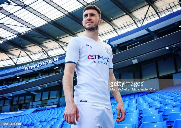 Aymeric Laporte of Manchester City models the 2021-22 season away kit at the Etihad Stadium on July 29, 2021 in Manchester, England.