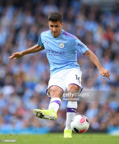 Aymeric Laporte of Manchester City passes the ball during the Premier League match between Manchester City and Tottenham Hotspur at Etihad Stadium on...