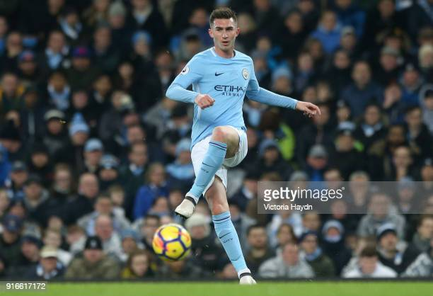 Aymeric Laporte of Manchester City passes the ball during the Premier League match between Manchester City and Leicester City at Etihad Stadium on...