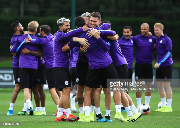 Aymeric Laporte of Manchester City reacts with teammates during the training session at Manchester City Football Academy on August 23 2019 in...