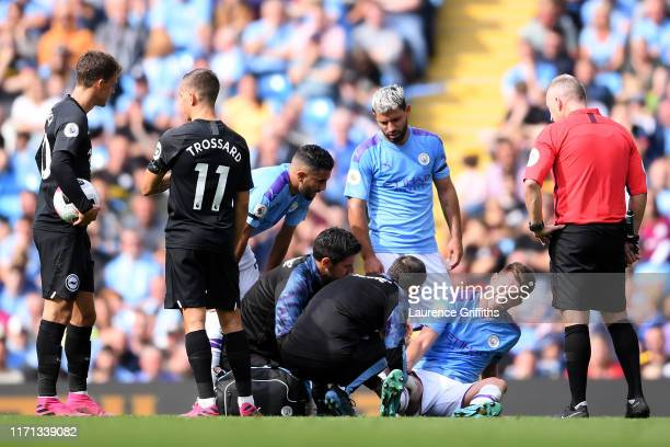 Aymeric Laporte of Manchester City receives medical treatment during the Premier League match between Manchester City and Brighton Hove Albion at...