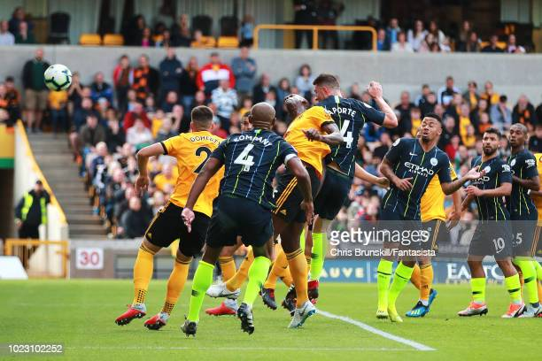 Aymeric Laporte of Manchester City scores his side's first goal during the Premier League match between Wolverhampton Wanderers and Manchester City...