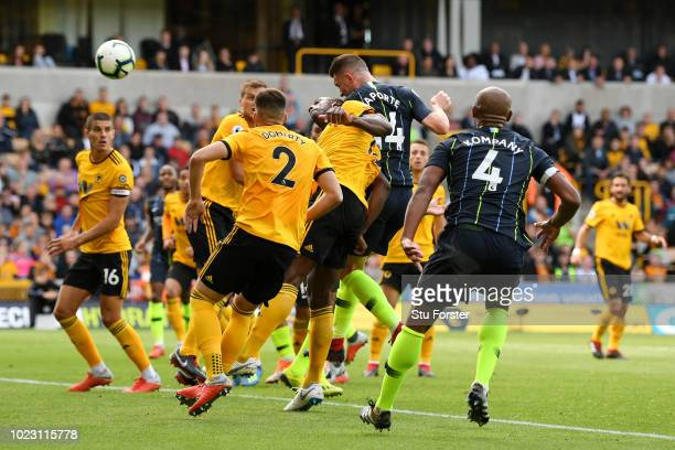 Aymeric Laporte of Manchester City scores his sides first goal during the Premier League match between Wolverhampton Wanderers and Manchester City at...