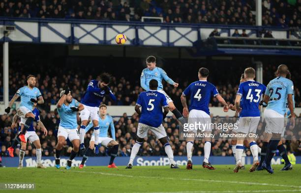 Aymeric Laporte of Manchester City scores his sides first goal during the Premier League match between Everton FC and Manchester City at Goodison...