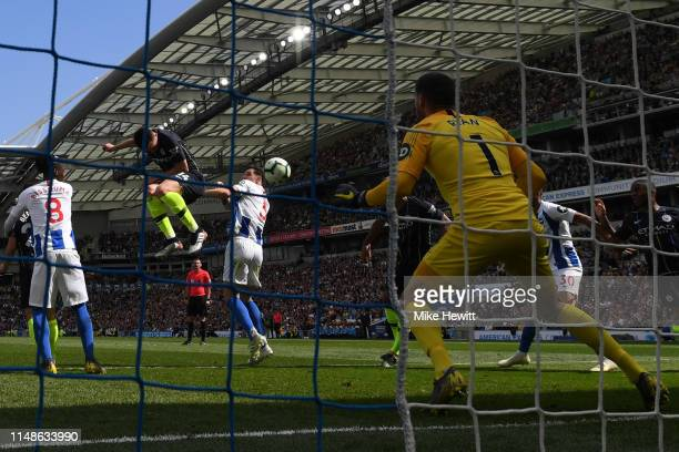 Aymeric Laporte of Manchester City scores his team's second goal past Mathew Ryan of Brighton and Hove Albion during the Premier League match between...