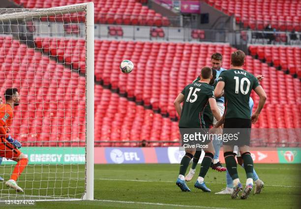 Aymeric Laporte of Manchester City scores their side's first goal past Hugo Lloris of Tottenham Hotspur during the Carabao Cup Final between...